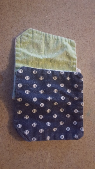 Place third wipe over the folded first wipe